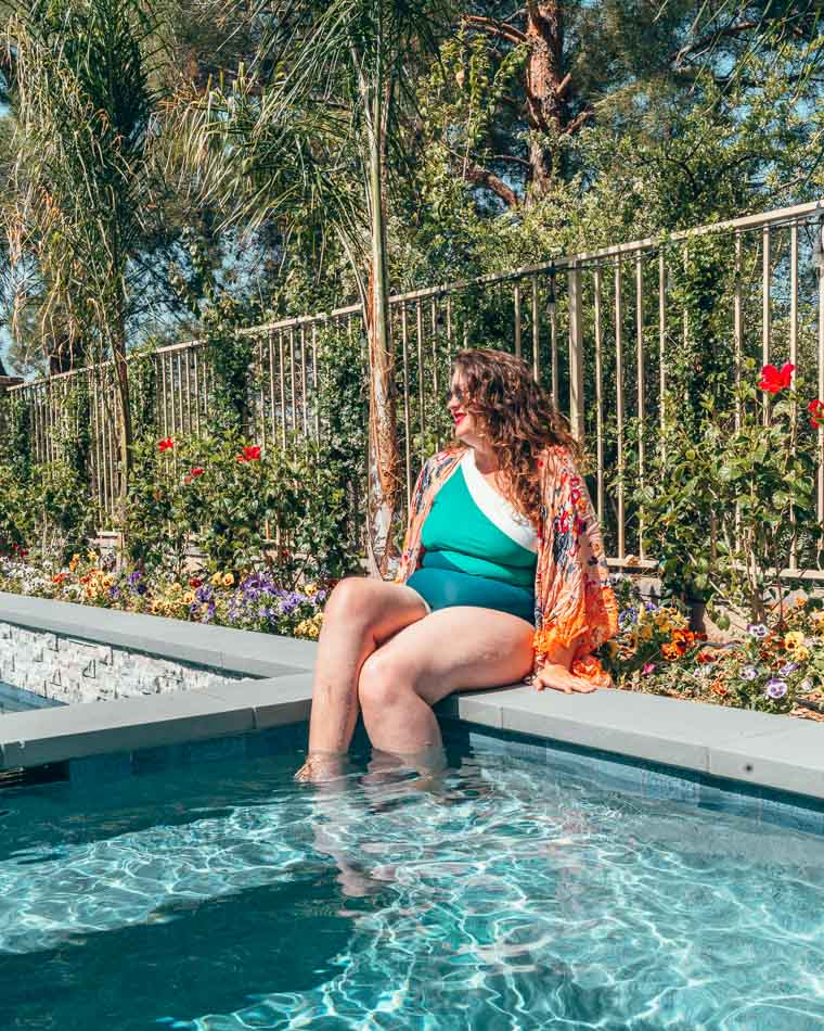 One shoulder Sidestroke swimsuit from Summersalt on a plus size girl in a pool