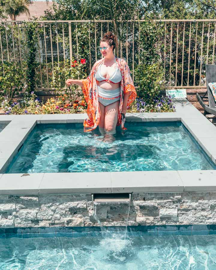 Plus Size girl in a Bikini at a pool wearing a pink cover up