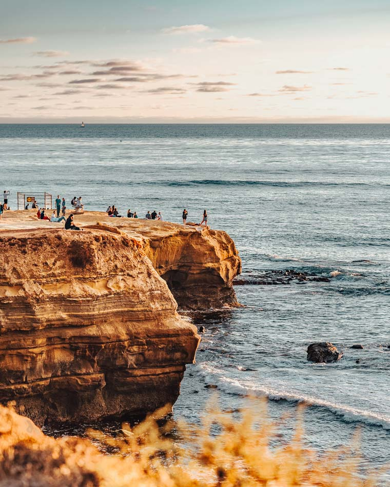 People hanging out at Sunset Cliffs in the evening in San Diego, CA.