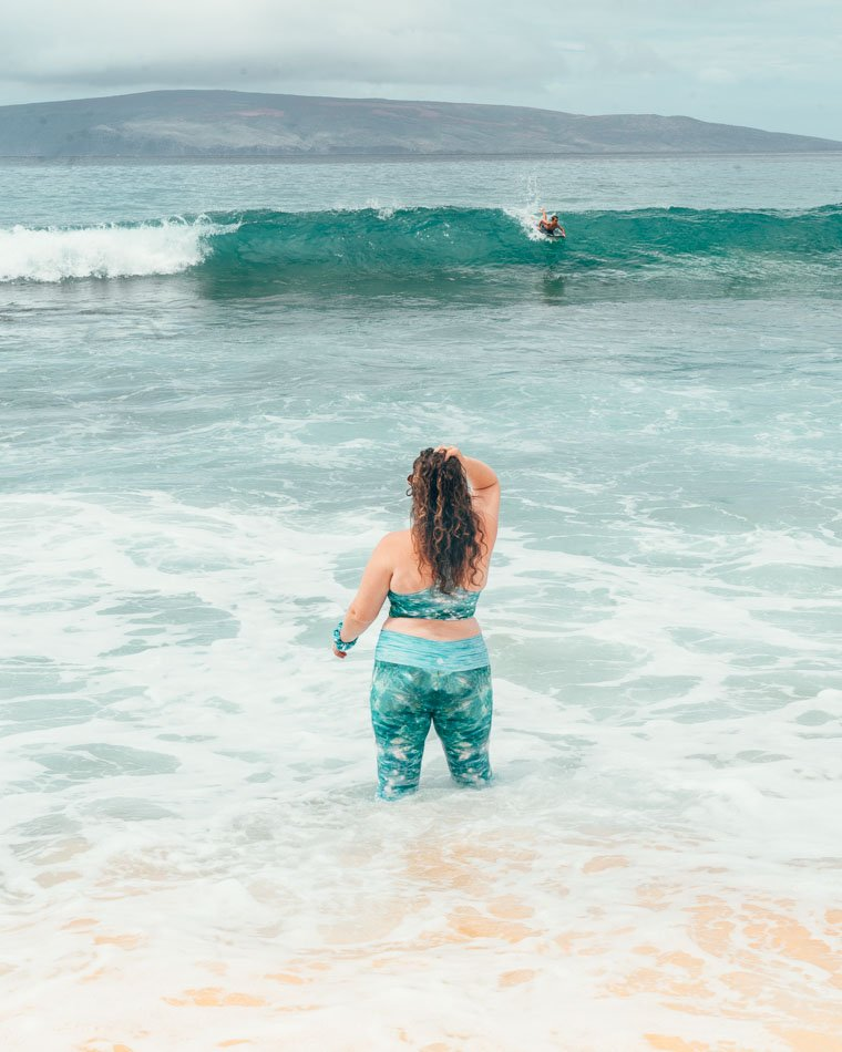 Girl wearing swim leggings and top in the ocean