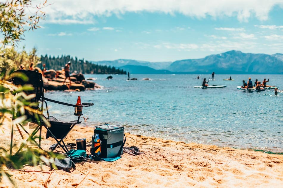 Beach chair and cooler at a lakeside beach in Lake Tahoe, California.