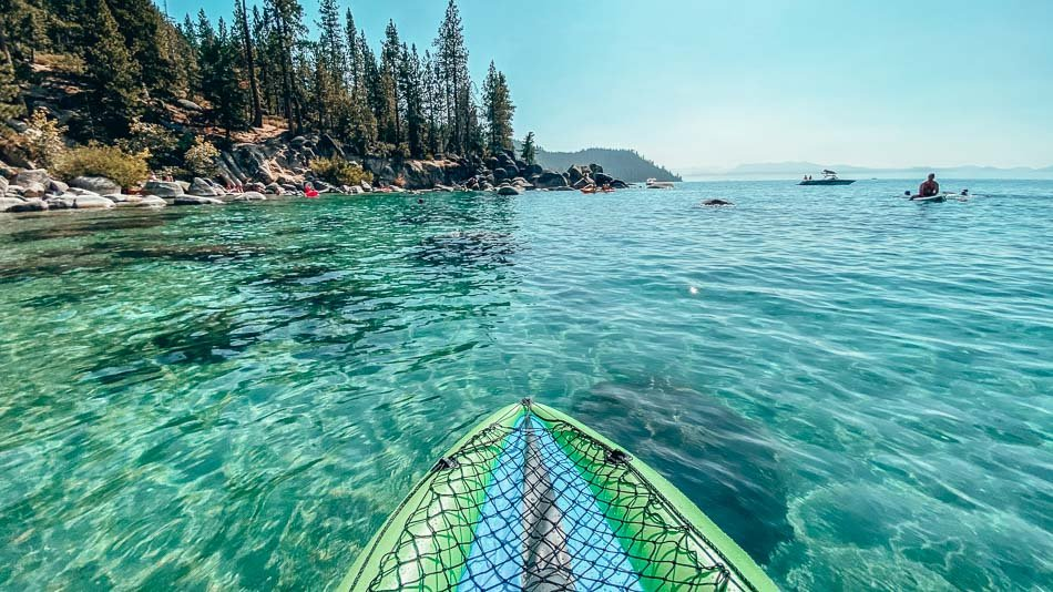 Kayaking in the crystal blue clear waters of Lake Tahoe, California in the summer