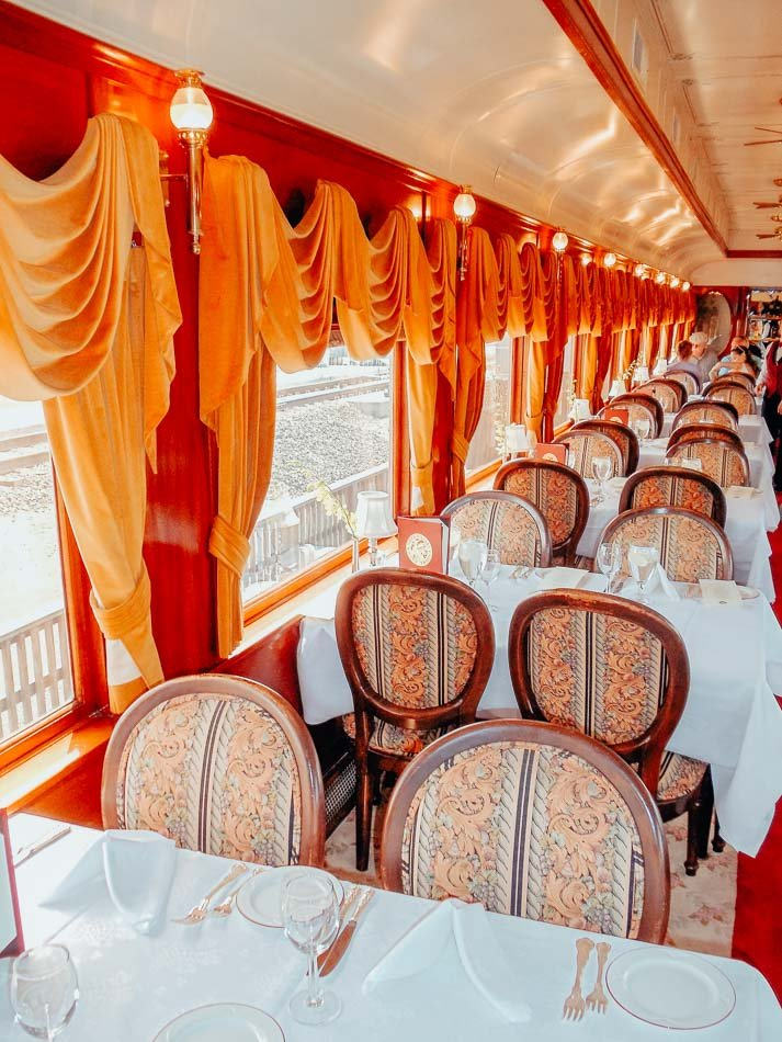 The dining tables inside the Napa Valley Wine Train in Napa, CA.