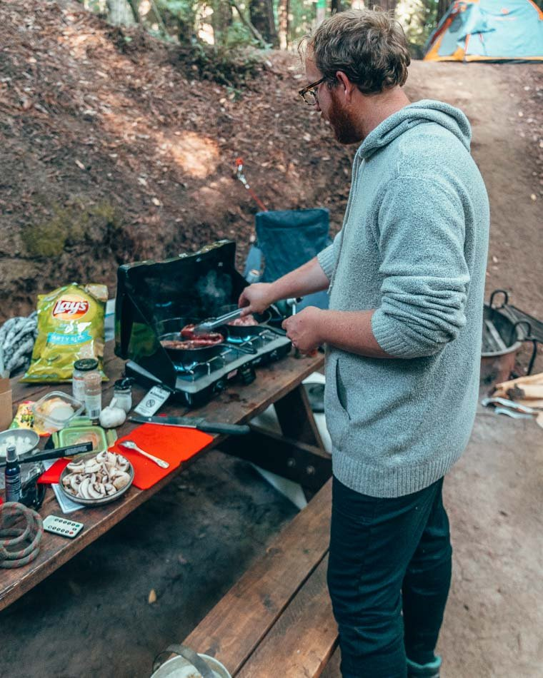 Jeremy cooking on a camping trip in Big Sur, California