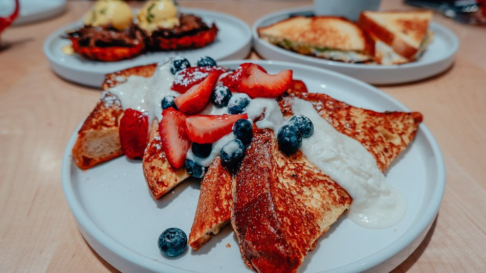 French toast with berries and cream on top at The Morning Fork in Louisville, KY