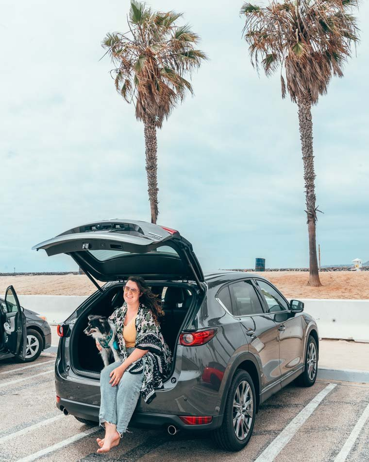 Lia and Mulan in a Mazda CX-5 on the beach in San Diego, California.