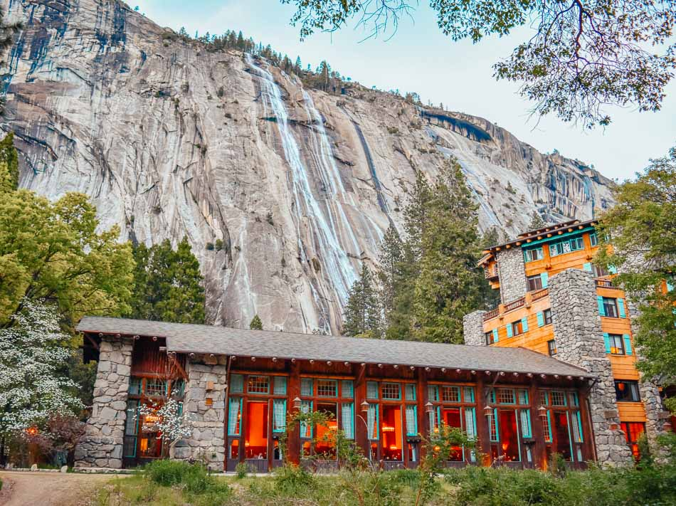 Lodge at the foot of the mountain with a view of the waterfalls at Yosemite National Park, CA