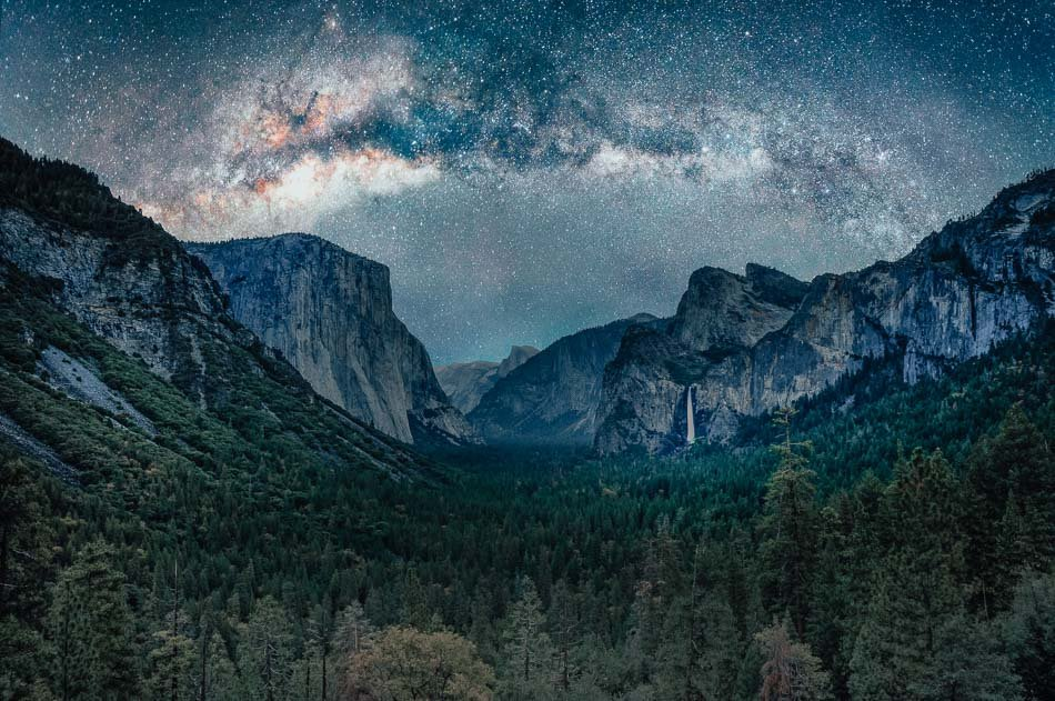 Yosemite Valley as seen from Tunnel View at night with the Milky Way overhead.