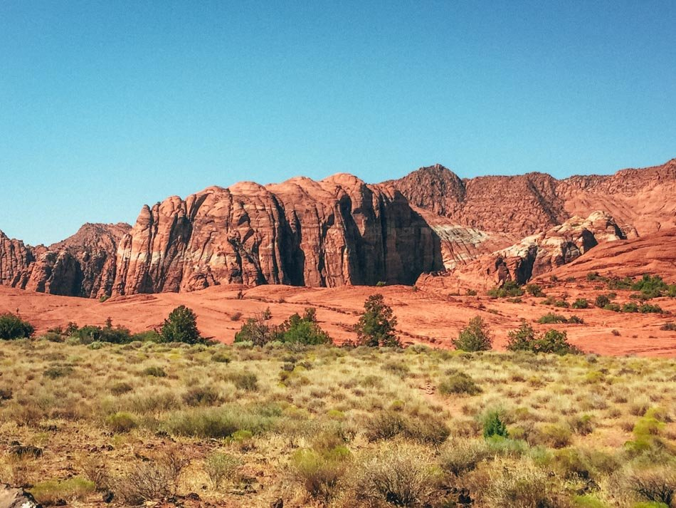 canyons in background with grass in foreground at snow canyon state park - flickr