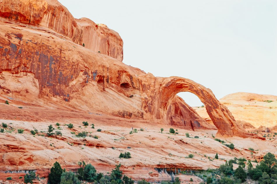 A view of Corona Arch in the background along Bowtie Arch Trail near Moab, Utah