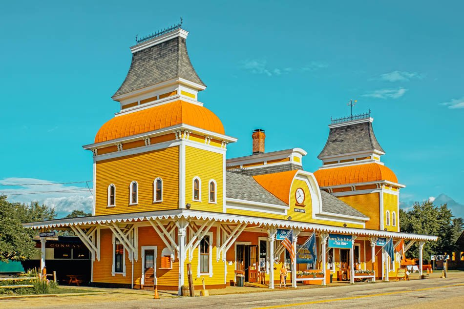 The yellow wooden exterior of the North Conway Railway Station in North Conway, New Hampshire