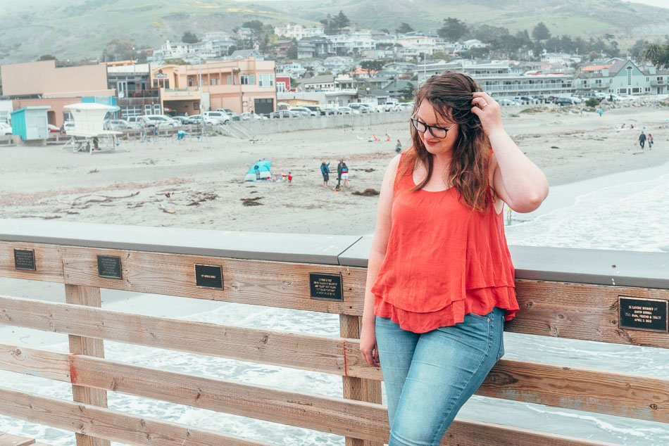 Lia standing on the Cayucos Pier near the beach in Cayucos, California on the Central Coast