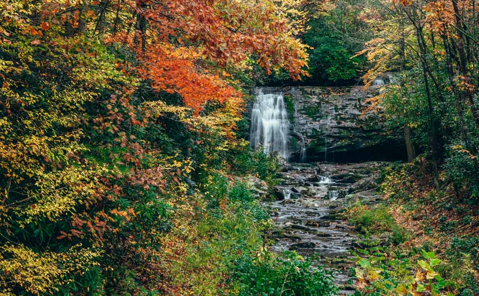 Meigs Falls waterfall surrounded by the fall colors in Great Smoky Mountains National Park