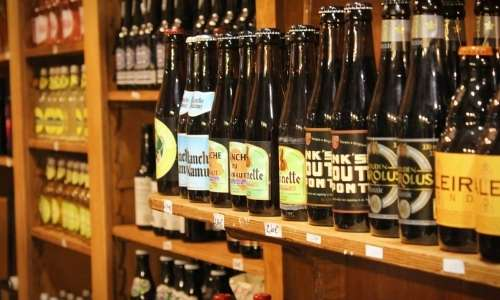Belgian beers lined up in a Belgian Beer Store. Belgian beer stores are a bit like like beer libraries.