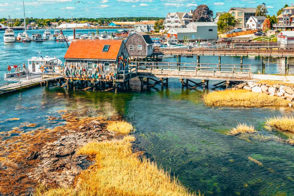 A view of the Portsmouth Harbor with wooden docks and wood shacks over water in Portsmouth, New Hampshire